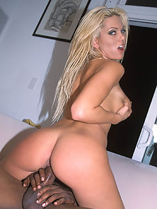 Hot blond fucks huge ebony cock