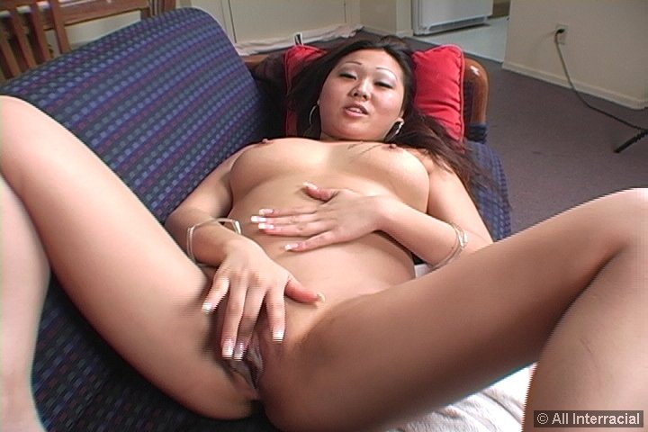 Sexy Asian spreads her juicy bald pussy lips