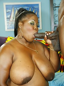 Black slut with giant tits sucking cock and getting nailed