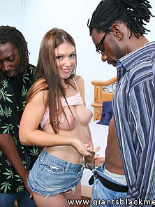 Cute blue eyed brunette gets hammered by a pair of black dicks