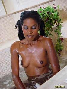 black babe carresing her body in a bedroom