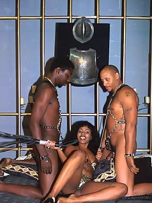 Enticing ebony hooker sucks two monster dark peckers with lust