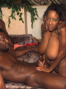 Big chested black babe giving a titty job and more