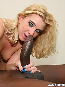 Wide eyed blonde slut sucks and fucks a huge black cock