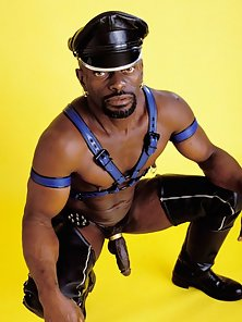 Ghetto brotha in black chaps and a cock ring
