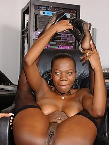 Sexy ebony sluts riding a strap on cock then sucking toes