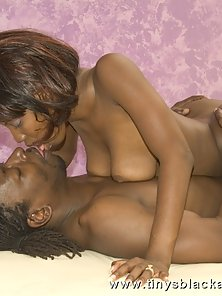 Chocolate sista has her legs pushed behind her head for hard black cock