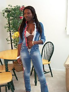 Luscious black babe stripping and spreading