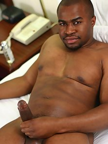 Studly black gay Jay pulls down his jeans to show off his black cock by rubbing it