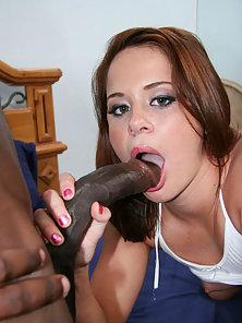Slutty young redhead goes deep with a huge black cock down her throat