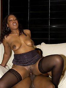 Busty ebony babe in stockings riding cock