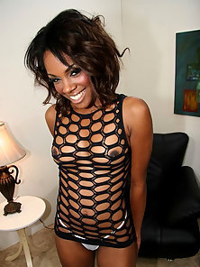 Fishnet outfit wearing ebony babe rides a black dick backward cowgirl