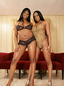 Brown skinned lesbian nymphos with big tits in action
