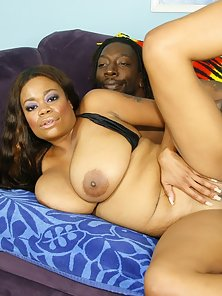 Busty ebony MILF on her knees sucking a big black dick