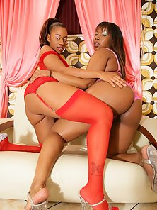 Ebony lesbian nymphos are getting it on with nubby sex toys