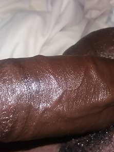 Big black dick, oiled up and ready to slide in some pussy or ass.
