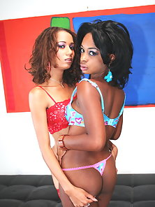 Ebony babes Mya and Vixen giving each other a horny kiss and lick