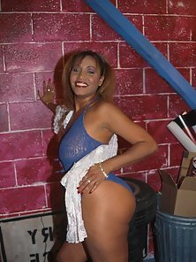 Huge boobed ebony bitch stripping her blue panties for you