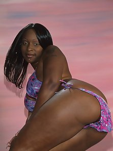 Big assed black babe spreads and rides a hard cock