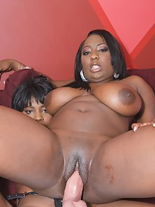 Big boobed black sluts fucking each other with toys