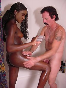 Dirty Ebony Babe Bathed With Oil and Gets Licked By the Hunky Man