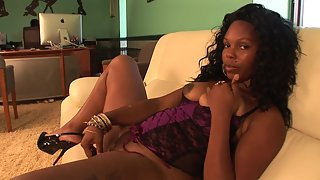 Mature ebony chick in corset plays with her pussy and fucks it with dildo