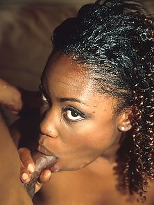 Big eyed black babe doin the reverse cowgirl