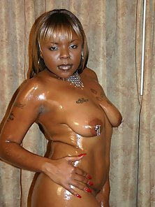 Blonde Haired Nipple Pierced Busty Ebony Slut Exposing Her Oily Nude Figure