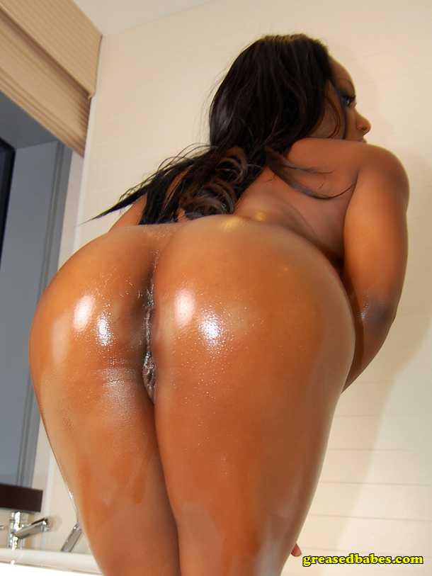 Sexy naked big oiled black ass