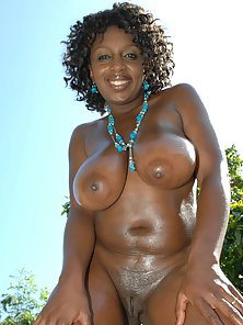 Curly Hair Ebony Ms Panther with Big Bosoms Spreading Juicy Twat
