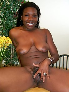 Ebony babe sucking and riding black cock on couch