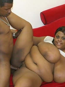Fat black babe playing with her tits and getting nailed