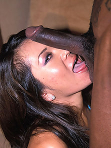Asian slut takes a black dick in her mouth and vagina