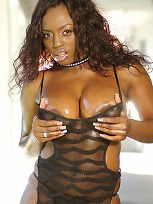 Lusty Lady Jada Fire Plays with Her Huge Boobs and Shows Her Round Butt