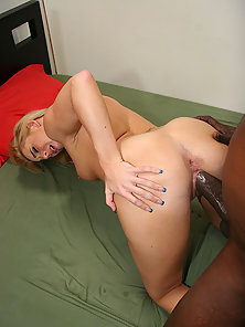 Blonde slut gets pussy pounded by a stiff black python cock