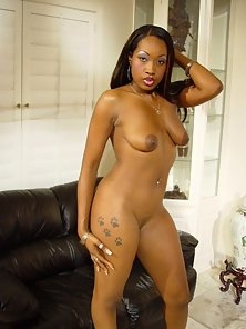 Hot ebony babe shows off body and pussy on couch